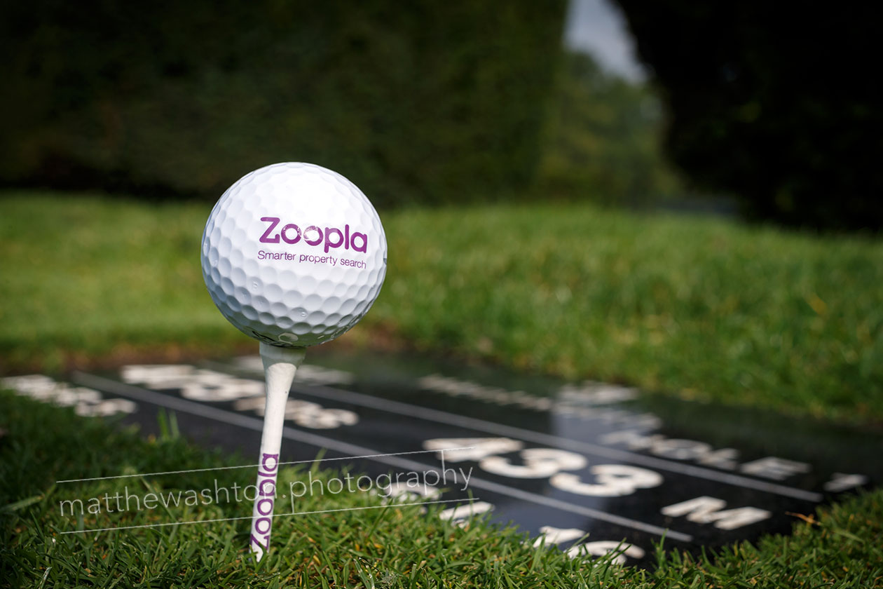 branded golf ball on tee